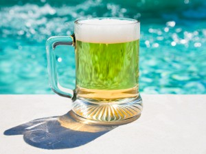 glass of cold beer in hot summer day